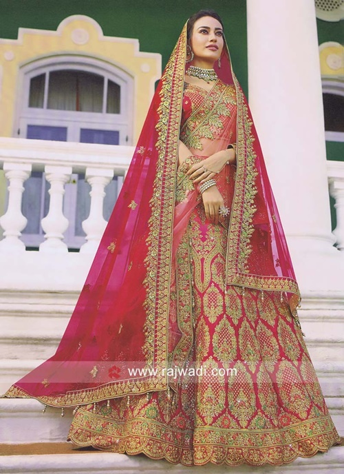 Double Dupatta - one over the head and other draped in normal saree style